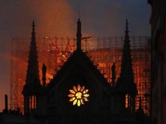 flames-and-smoke-rise-notre-dame-cathedral-it-burns-paris-monday-april-15-2019-massive-plumes-yellow-brown-smoke-filling-air-above-notre-dame-cathedral-and-ash-falling-tourists-and-others-around